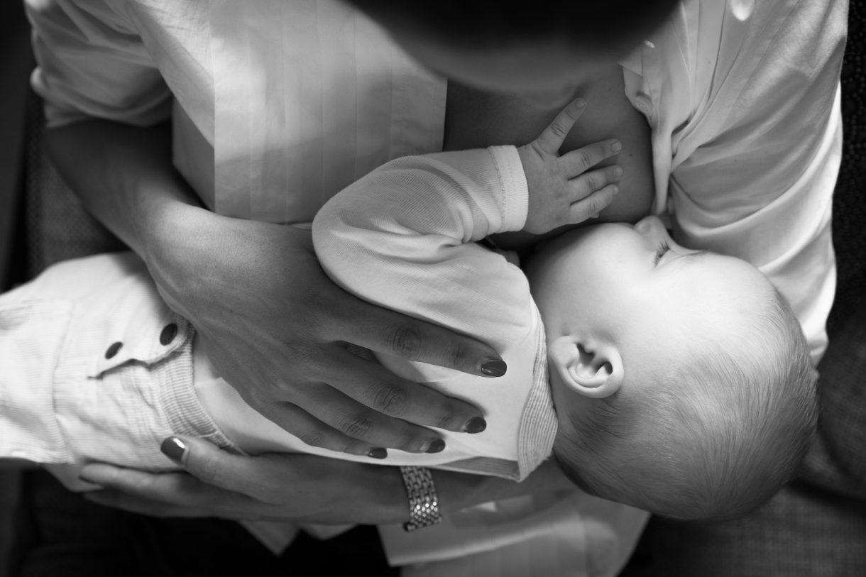 Woman cluster feeding/breastfeeding a baby